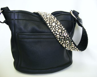 The Ball Buster bag in Black leather black stitch, stones and studs on shoulderstrap
