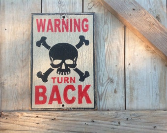 Warning turn back sign made from reclaimed plywood