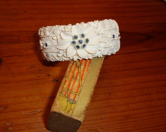 Marvelous 1950s FEATHERWEIGHT Vintage CARVED Celluloid Floral Hinged Clamper with SAPPHIRE Blue Cabachons