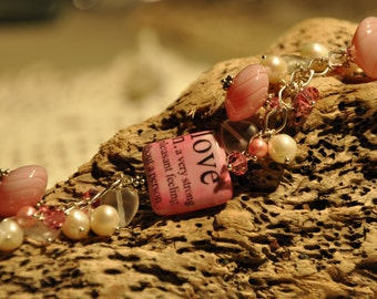 Definition of 'Love' Charm Bracelet