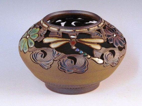 Round Vase With Dragonflies, Flowers, Swirl Design, And Cutouts With Texturing Near Bottom