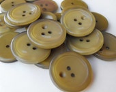 "11 Olive Green Face Round Buttons Size 1 1/16""."