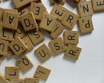 Aged loose scrabble tiles . 90 plus pieces . vintage scrabble tiles . aged Scrabble tiles . letter tiles for art projects . yellowed tiles