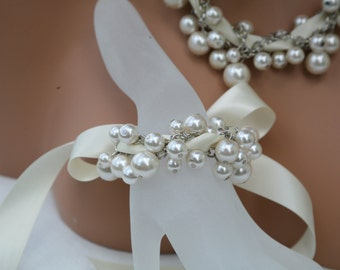 Special 16 dollars message me for other colors of ribbon and pearls.  Bridesmaids jewelry-wedding bracelet.