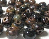 Rustic Porcelain Beads In Mustard and Brown tones on Black 8.5mm hand Formed 12 pieces