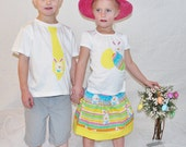2 shirts Brother Sister or twins Easter shirts, girl pink, blue and  yellow eggs and bunny appliqued, and a boy yellow polka dot tie shirt