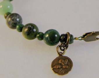 Green gems and brass bracelet: charity donation