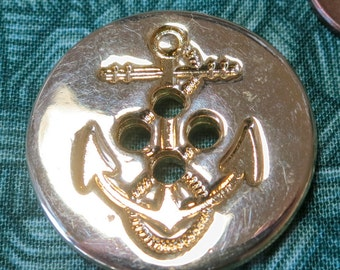 Vintage, gold toned 4 hole coat button,1 inch across,  with impressed anchor motif. . PFM12.1-29.49/PVFM12.7-17.30.
