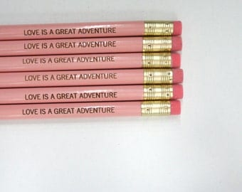 love is a great adventure 6 engraved pencils in pastel pink.