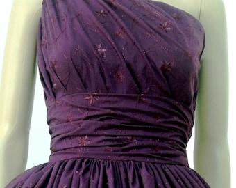 A cotton eyelet burgendy 50s dress