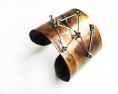 Metal cuff bangle made of oxidized copper and stainless steel adjustable