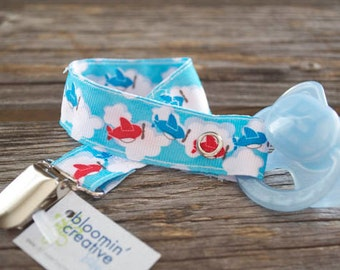 Airplane print ribbon pacifier/toy clip