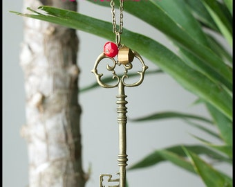Antique Brass Skeleton Key Necklace with Brass Faceted Bead and Red Faceted Bead