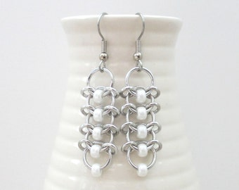 Chainmaille earrings with pearly white beads, Centipede weave