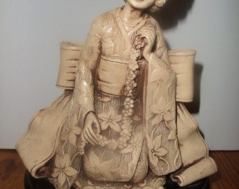 Faux Ivory or Mandarin Ivory Geisha Girl Kneeling Statuette on Wooden stand c 1920s