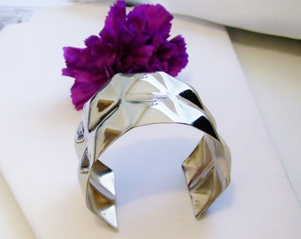 Wide Cuff Bracelet with elaborate design, Wide and shiny, ornate cuff and it fits all size wrists....