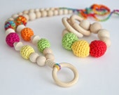Bright colorful t set of 2. Teething ring toy and nursing necklace. Multicolor rattle for baby and mom.