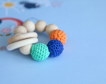 Teething toy with crochet wooden beads and 2 wooden rings. Blue, orange, green wooden beads rattle.
