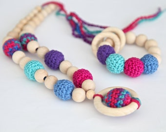 Dark bright set of 2. Teething ring toy and nursing necklace. Multicolor rattle for baby and mom.