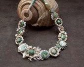 Sea shell fiber necklace, crochet with fabric buttons, cream emerald green turquoise, OOAK