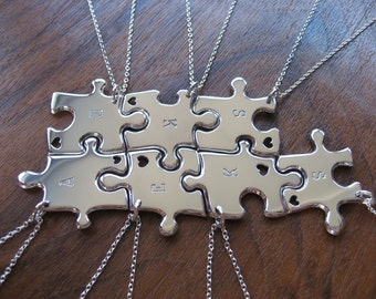 Seven Initial Stamped Silver Pendant Necklaces with hand cut hearts