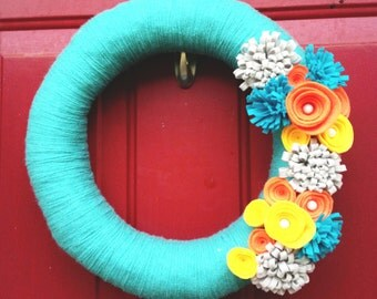 "12"" Teal Yarn Wreath with Yellow, Orange and Gray Felt Flowers"