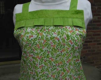 Full apron green leafy print with pockets