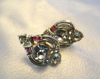 Earrings with clear rhinestones and pink trims, beatufiul.