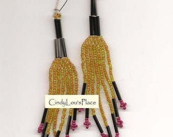Simply elegant Earrings.  Native American Made.  The Orange beads have a Green tint to the outside of the Bead.