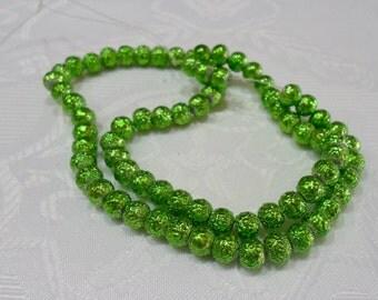 251-1 Perle de acrylic texturé  6mm   couleur vert  1 corde