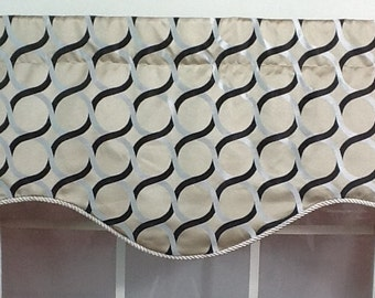 Contemporary shaped valance with cord trim in black, natural and purple