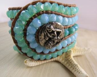 Leather beaded cuff bracelet with a mermaid and ocean colored Czech glass beads, bohemian, surfer chic