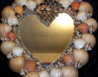 nautical mirror encrusted with sea shells