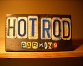 Hot Rod parking sign made with recycled license plates.