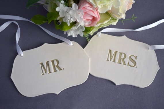 Gold Mr And Mrs Wedding Sign Set To Hang On Chair By