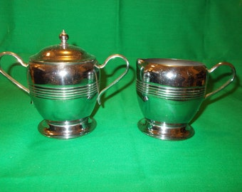 One (1) 1940's Chrome Creamer and Sugar Bowl with Lid. Unmarked
