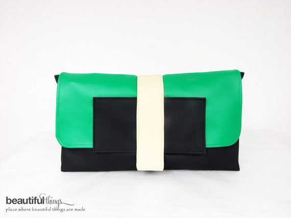 Green and black oversized clutch with long strap