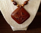 Handmade necklace, wood carved pendant with copper beads and brown/gold freshwater pearls