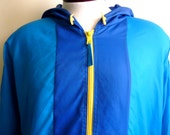 bright 80's vintage HELLY HANSEN color block anorak, water proof, blue and teal panelled with yellow zippers