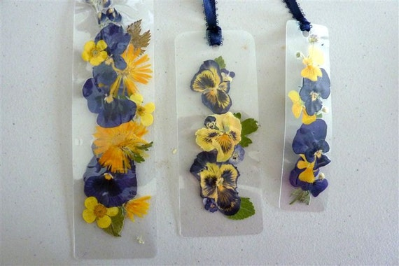 Laminated pressed flower bookmarks with dark blue