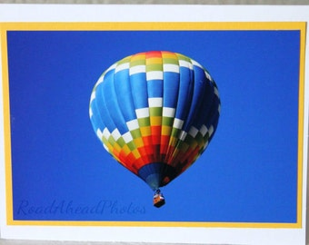 photo card, multi colored hot air balloon, blue sky