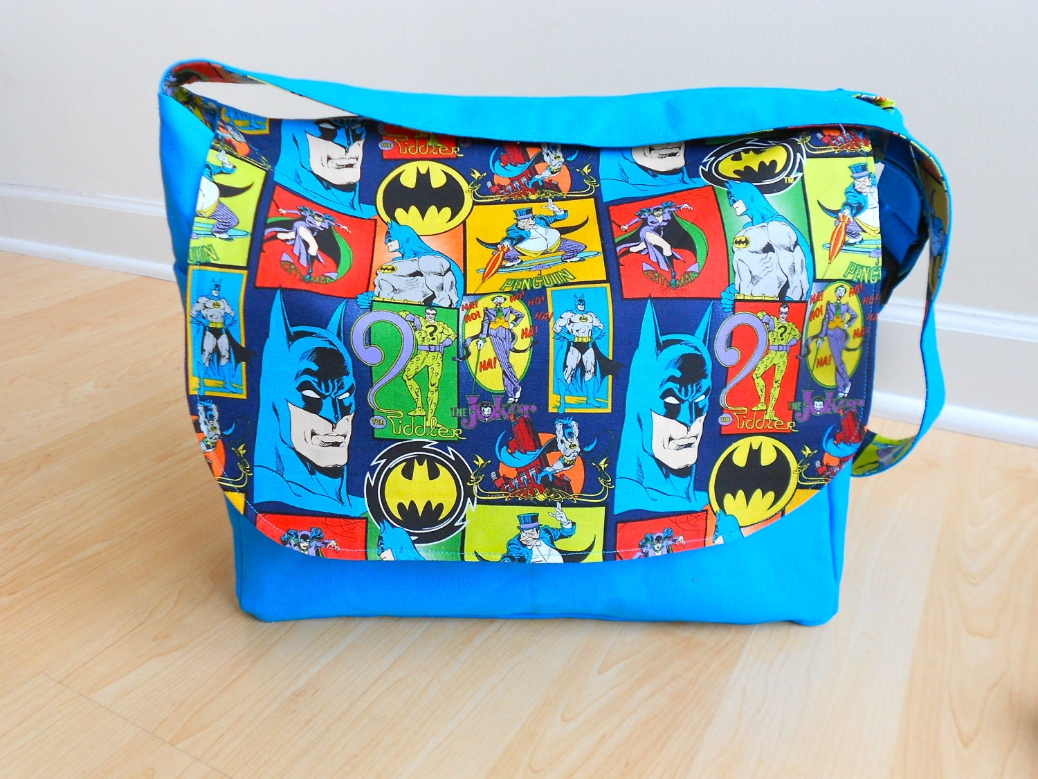 Batman Messenger/Diaper Bag - Blue with Joker, Catwoman, Penguin, Riddler on Etsy, $ Find this Pin and more on Batman diaper bag by Sera Sprague. Batman Messenger/Diaper Bag - Blue with Joker, Catwoman, Penguin, Riddler.