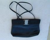 dark black FERREGAMO hand bag made in Italy pre-owned circa 1962's security code