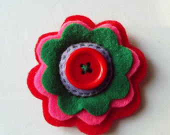 Felt flower brooch with a red button