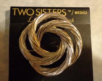Vintage Two Sisters silvertone swirl brooch