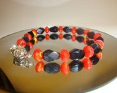Orange and Black Beaded Bracelet please find this at WhimsicalTreasures2 here on etsy
