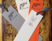 Revolver calligraphy bookmark, grey, cream or orange in matt finish with black and white checked ribbon