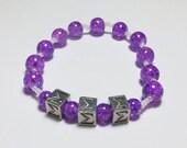 Pewter Tri Sigma and Purple Glass Stretch Bracelet