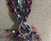 Lanyard,or Scarf with multi colors of pink, lt turquoise, white trimmed in black (ribbon yarn)