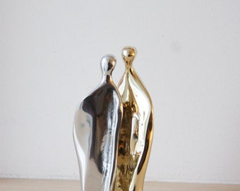 Man-woman abstract sculpture, brass and aluminum set of two sculptures nesting into each other, gold silver couple sculpture